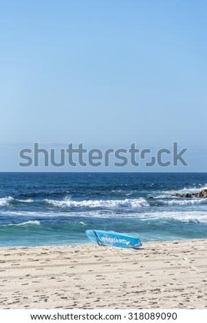 Lifeguard surfboard on a beach. - stock photo
