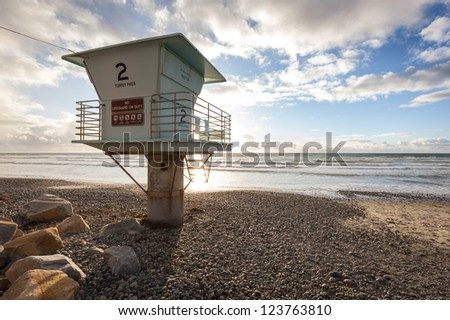 Lifeguard tower at ocean on beautiful sunny day - stock photo