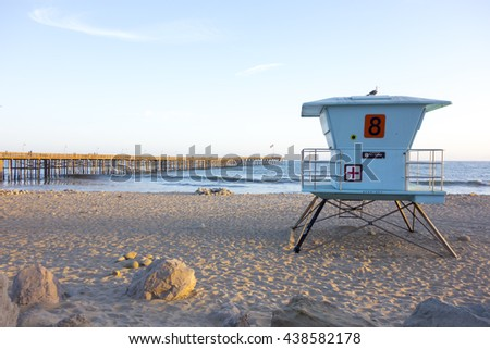 Lifeguard tower at San Buena Ventura city beach near historic wooden pier, Southern California