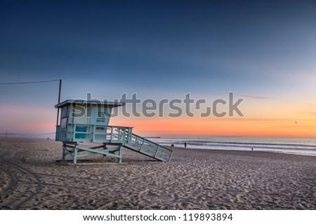 Lifeguard tower at Venice Beach, California at sunset. - stock photo