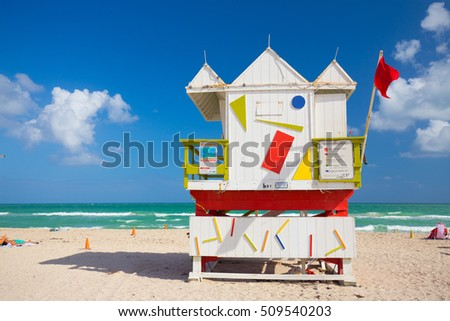 Lifeguard tower in a colorful Art Deco style, with blue sky and Atlantic Ocean in the background. World famous travel location. Miami beach, South Beach, Florida