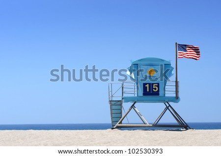Lifeguard tower with American flag on an open beach