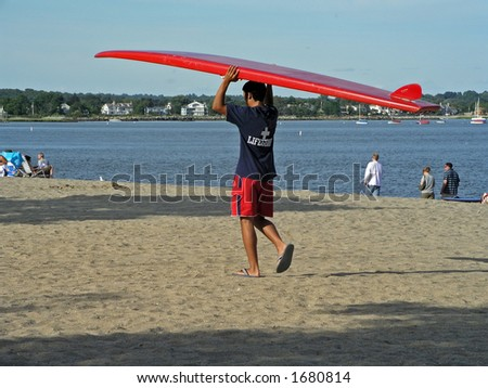 Lifeguard with surfboard - stock photo