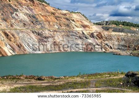 Lifeless pond in a quarry - stock photo