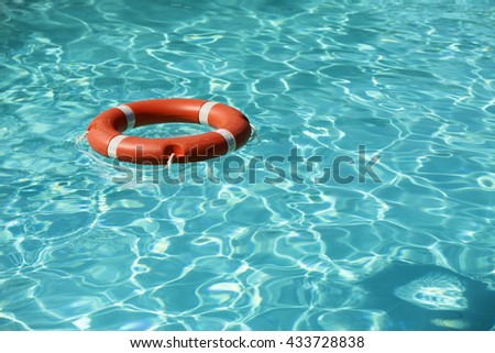 Lifesaver floating in the swimming pool. - stock photo