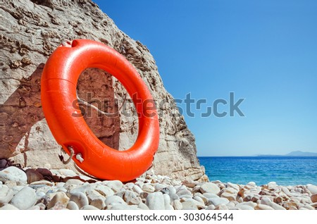 lifesaver on the beach - stock photo
