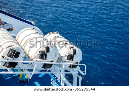 Lifesaving equipment on deck of a cruise ship - stock photo