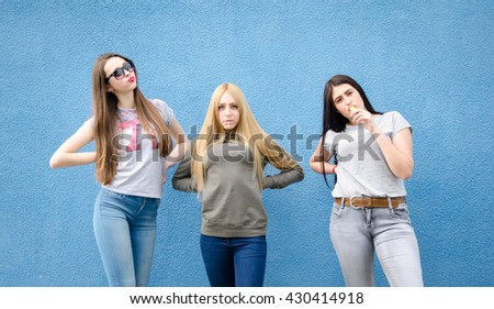 lifestyle and people concept: Fashion portrait of three stylish sexy girls best friends, over white background. Happy time for fun. - stock photo