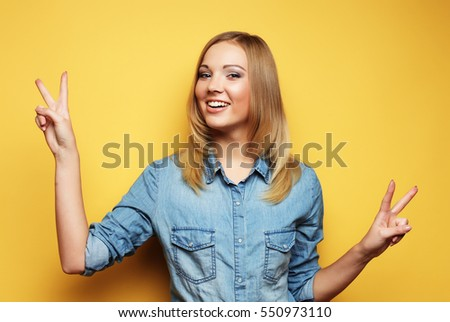lifestyle  and people concept: lovely woman showing victory or p