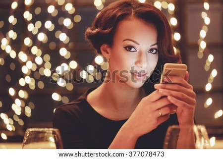 Lifestyle. Beautiful woman in restaurant