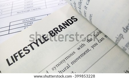 Lifestyle brand word on the book with balance sheet as background