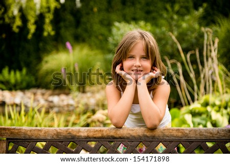 Lifestyle child portrait - little girl  outdoor in backyard - stock photo