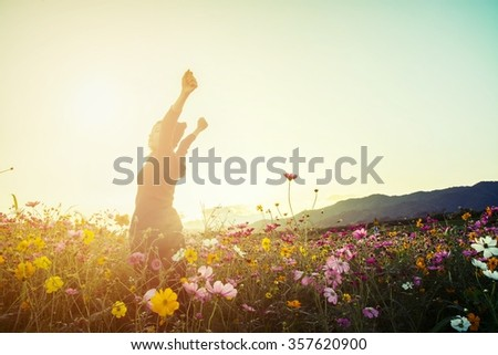 lifestyle concept - beautiful happy woman enjoying fresh air in cosmos flower field - stock photo