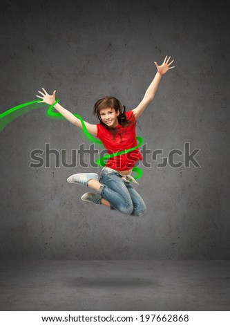 lifestyle, dancing and people concept - happy jumping teenage girl - stock photo