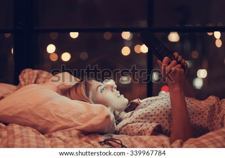 Lifestyle, home. Girl lying in bed