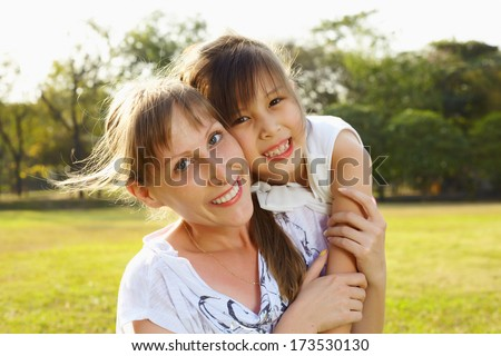 Lifestyle mum with daughter in funny pastime at the park outdoor
