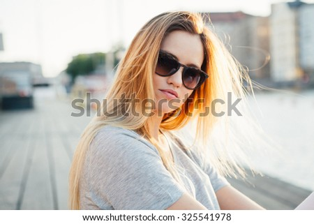 Lifestyle portrait of a young attractive woman - stock photo