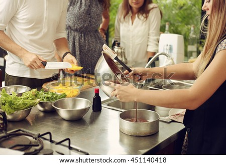 Lifestyle portrait young male person in the real kitchen - stock photo