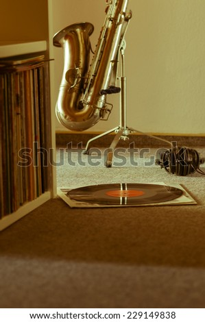 Lifestyle, Still Life with records, saxophone with headphones.
