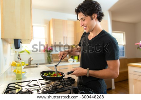 Lifestyle young hipster attractive modern man at home with vegetarian recipe fajita grill - stock photo