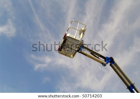 Lift Bucket Closeup Against Blue Sky Background - stock photo