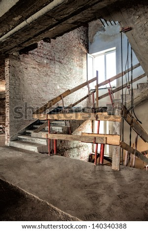 Lift shaft and staircase on a construction site - stock photo