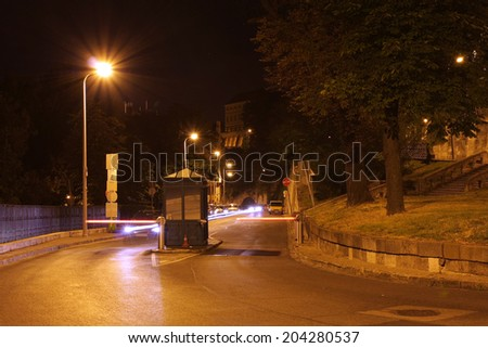 Lifting barrier gate with lighting arm