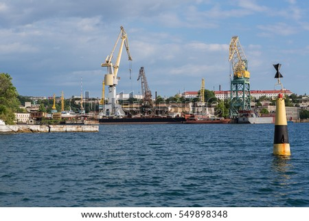 Lifting cargo cranes at the shipyard in Bay of Black Sea, Russia