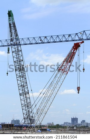Lifting crane in site construction - stock photo