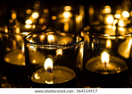 Light a candle in a glass jar