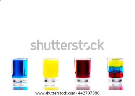 Light alcoholic colored shots isolated on white - stock photo