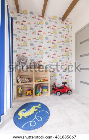 Light and cosy room with many toys and colourful wall paper