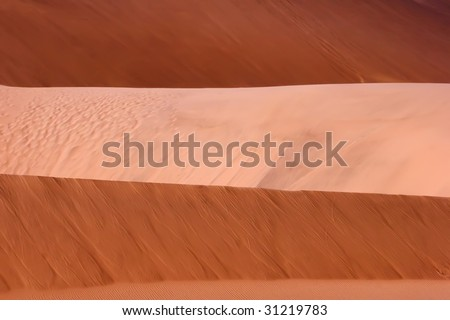 light and dark layers of red dunes - stock photo