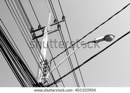 Light and electricity pole in gray background