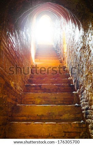 light at end of tunnel in castle, Bagan, Myanmar - stock photo