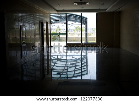 Light at the end of hospital corridor. - stock photo