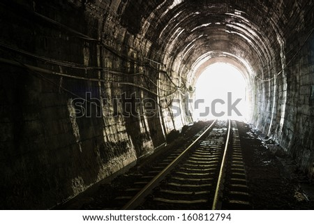 Light at the end of railroad tunnel. Khuntan tunnel ,Thailand - stock photo