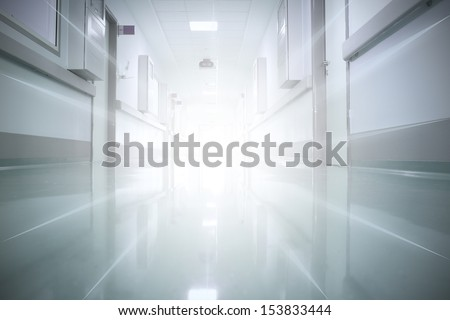 light at the end of the corridor. The concept of religion, life and death. - stock photo