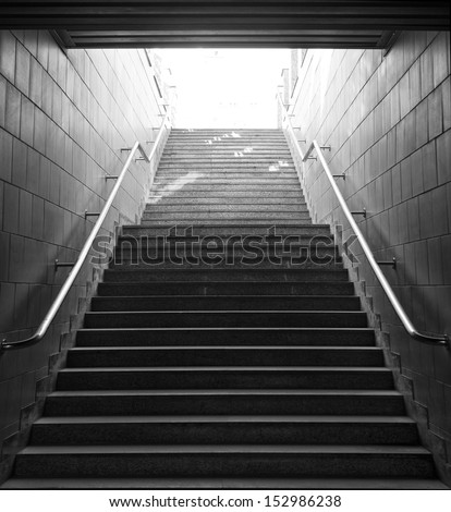 Light at the end of tunnel. black and white photo - stock photo