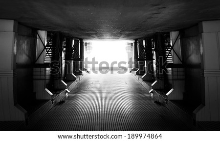 Light at the end of tunnel.Low grain added for create atmosphere - stock photo