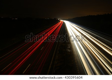 Light beam of cars in the night - stock photo