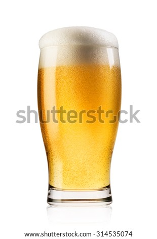 Light beer with the foam poured into glass isolated on white background