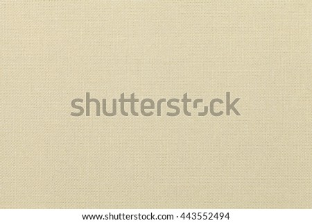 light beige background from a textile material. Fabric with natural texture. Cloth backdrop. - stock photo