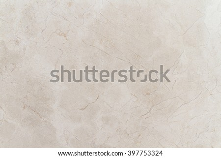 Light beige exquisite marble Crema Natura. The texture of natural stone with a uniform pattern with chaotic splashes and streaks of light. Building materials for interior finishes.