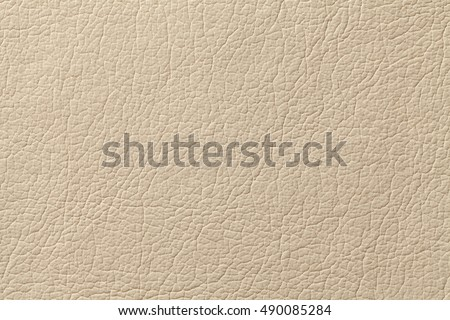 Light beige leather texture background with pattern, closeup.