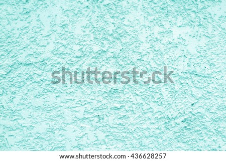 Light blue cement wall is plaster rough style background