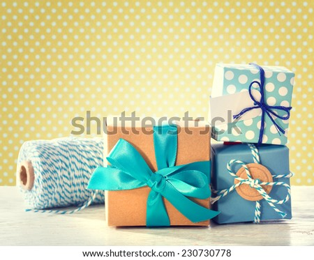 Light blue handmade gift boxes over polka dots background - stock photo