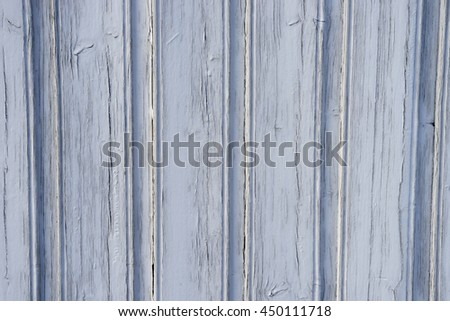 Light blue paint on old wood