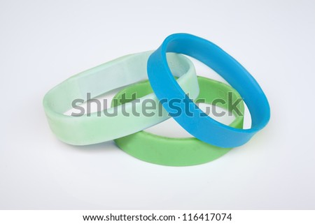 Light blue rubber bracelet. Yellow is color of King, light blue is Queen of Thailand. - stock photo