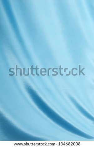 Light Blue Satin Fabric Draped for a Background - stock photo